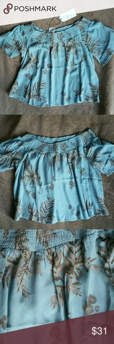 BNWT Sweet & Sexy Sadie & Sage Off Shoulder Top BNWT Sweet & Sexy Off Shoulder Top Made with love in USA. Designed in California! 100% Rayon Beautiful pure blue. Color is more like Las 3 pics. Not as bright as first pic. Perfectly sweet. Comes in bag with tags. Sadie & Sage Tops