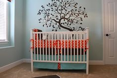 ... this is perfect. I want a tree in his room...his room is already this color and blue, orange and brown is my favorite color combination!