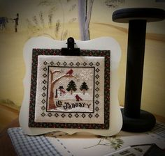 Love the frame and mounting of the cross stitch piece.  Well done!