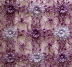 Solomon's knot join for loomed flowers from my website by knittingand, via Flickr
