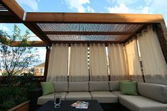 Another way to add some privacy to the backyard deck. Am going to do this look with sheer curtains instead.