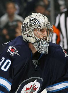 Connor Hellebuyck #30 of the Winnipeg Jets