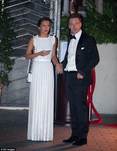 Hand in hand: Alicia Vikander and Michael Fassbender showed some PDA at a Golden Globes after party at the Sunset Tower on Sunday