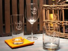 These large 18 oz. wine glasses etched with an iconic nautical motif of an anchor image wrapped with a length of rope is the perfect touch for that coastal or nautical vibe at your table. (Or on board