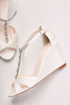 24 Wedding Sandals You Can Definitely Wear Again - white open toe wedge heels with t-strap front featuring silver and pearl beading - David's Bridal Veni pearl and crystal t-strap wedges, $70, David's Bridal