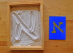 use Sandpaper Hebrew letters, they traced it with their fingers then traced it in the sand: