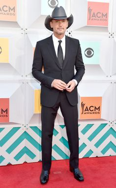 "Tim McGraw from ACM Awards 2016 Red Carpet Arrivals  After sharing a sweet kiss with Faith Hill on Instagram, the ""Humble and Kind"" singer walks the carpet solo."