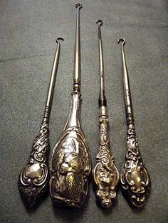 Four Victorian hallmarked silver buttonhooks, with foliate scrolled embossed handles on tapering steel shafts. (4)