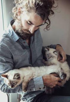 Man w his cat buddies
