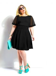 New Arrivals at Monif C. Plus Sizes - Monif C #slimmingbodyshapers   This versatile plus size dress is sure to become your go to for office parties, dressy occasions and a night on the town! A classic plus size cocktail dress in a shape that flatters every body type slimmingbodyshapers.com