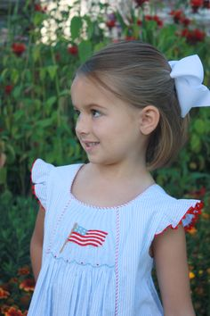 Hand smocked flag on our Anna Dress! Get Memorial Day and Forth of July Day ready!