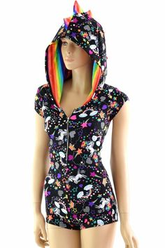 Neon UV glow rainbow and unicorn print lycra spandex, with rainbow striped spikes!Cap sleeves, spiked down the back and down the full hood, and boy cut legs.The