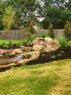 """A new Water Garden and stream with beautiful plants to accent. A """"Backyard Paradise""""!"""