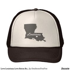"""Love Louisiana Love Baton Rouge Trucker Hat This simple but meaningful design features the silhouette of the state of Louisiana. Text flow through the state spelling out the word """"Louisiana"""" while a heart sits over the capital of Baton Rouge. This hat design is available in various colors and styles."""
