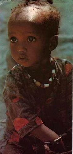 West Africa | A little girl in Dakar, Senegal. Photographer Michel Renaudeau.