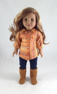 Orange striped button up top and leggings outfit by MjsDollBoutique18T on Etsy. Made from a modified version of the Button Up Shirt and the Leggings patterns. Get them here http://www.pixiefaire.com/products/button-up-shirt-18-doll-clothes. http://www.pixiefaire.com/products/leggings-18-doll-clothes. #pixiefaire #buttonupshirt #leggings