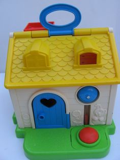 Fisher price discovery cottage... I think my brother might have had this... I just remember thinking it was cute!