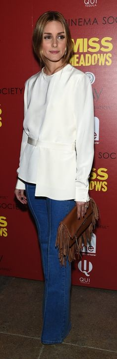 Olivia Palermo inspired our obsession with the high-fashion hair tuck in this cream blouse.