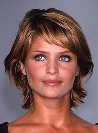 """Helena Christensen's medium-length, bi-level haircut (the way the front forms a """"C"""" around the face is a clue that it's a bi-level) and the short, side-swept bangs would look awesome today."""
