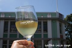 drinking cottage block chardonnay @ emporium eatery & bar in napier, new zealand