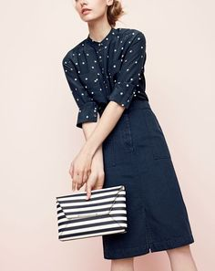 J.Crew women's silk popover in polka dot, A-line skirt with pockets and striped leather envelope clutch.