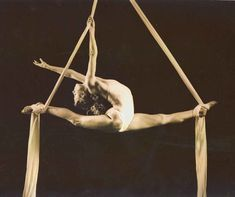 Train in Aerial Silks  Performers climb suspended fabric without the use of safety lines, and rely only on their training and skill to ensure safety. They use the fabric to wrap, suspend, fall, swing, and spiral their bodies into and out of various positions.