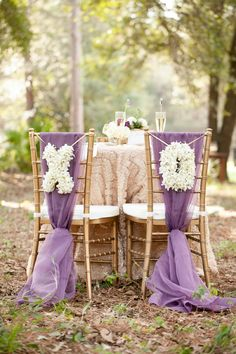 Gorgeous chair décor. // photo by http://bumbyphotography.com, via http://theeverylastdetail.com/rustic-chic-champagne-purple-wedding-inspiration