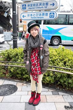 Harajuku girl in a top hat who we met near the famous LaForet department store. Other items in her look include a bomber jacket, a cat backpack & high top creepers.