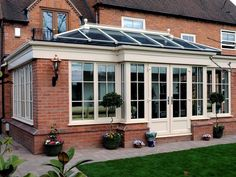 Cream UPVC brick built orangery with astragal bar and cornice gutter and french doors orangery extension Orangerie Extension, Orangery Extension Kitchen, Conservatory Extension, House With Porch, House Front, My House, Garden Room Extensions, House Extensions, Orangery Roof