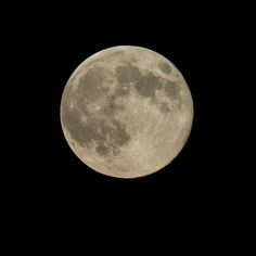 "A perigree full moon or ""supermoon"" is seen, Sunday, Aug. 10, 2014, in Washington. A supermoon occurs when the moon's orbit is closest (perigee) to Earth at the same time it is full"