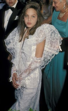 Angelina Jolie at the 1986 Oscars, looking fabulously over the top.