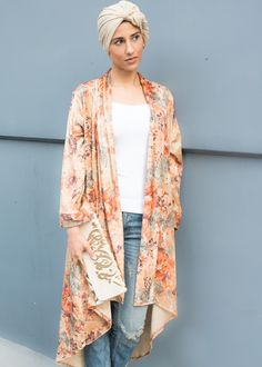 A luxe look in the velvet floral kimono. Sweeping longer length in the back and draped collar this kimono can elevate any outfit. One size fits most. Hand wash or dry clean.