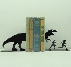 T-rex attack metal art bookends. This set of bookends is handmade and designed by Knob Creek Metal Arts. T Rex Jurassic Park, St Pierre, Literary Gifts, Book Lovers Gifts, Day Book, Metal Art, Book Worms, Cool Stuff, Stuff To Buy
