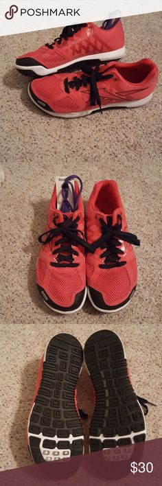 Reebok crossfit sneakers Pink with black laces; also have an extra pair of purple laces; only worn a couple times Reebok Shoes Athletic Shoes