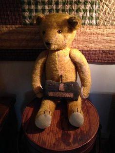 old bear sitting on old firkin in hallway