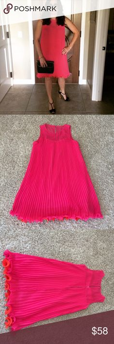 Hot pink Anthroplogie dress Hot pink pleated Anthropologie dress. Sweetheart bodice. Worn once. Flirty and fun.  Orange tipped underlay. Hidden underneath when the dress is on. Anthropologie Dresses