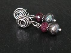 "Ruby, faceted pearl and sterling silver ""rose"" ear posts."