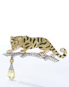 Suite of yellow diamond, onyx, emerald and diamond jewels, 'Sherkhan', Cartier   lot   Sotheby's