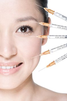 A row of syringes near a young woman's face -