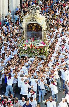 The feast of Our Lady in Calabria and the annual religious procession.