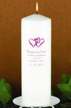 """""""Linked at the Heart"""" Wedding Unity Candle made of solid white wax.  The front of the candle is printed with two interlocking hearts. Below the hearts you can include your names. The candle is then printed with the phrases """"United in Marriage"""" and """"United in Love"""" separated by a line. You can then include your wedding date. The printed image and text are available in multiple ink colors."""