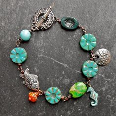One Little Fish  aqua orange and silver tone bracelet by songbead, £30.00