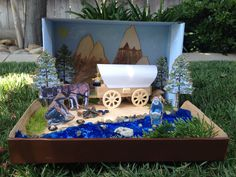 "Jacob's California Gold Rush Project- (for the water I used a blue cellophane bag that I crumbled up for texture & glued the river rocks & ""gold"" with clear silicone."