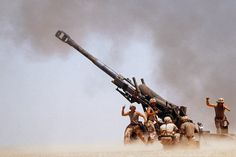 Troops on ground firing M198 Howitzer gun [3360x2240]