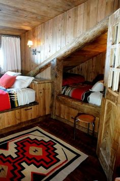Bunk rooms and sleeping nooks maximize the bedroom space; there are three beds in this room. Pendleton blankets keep things cozy.