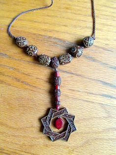 Amulet of Arkay inspired by Skyrim. $17.50, via Etsy.