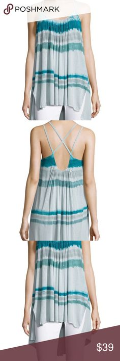 Free People Blue Fly By Tank in Aquamarine Combo This is a Free People Blue Fly By Tank in Aquamarine Combo. Size: XS. Color: Blue. MSRP $78. NWT. * Tie dye stripes and strappy shoulders style the Fly Away Tank, cut from a rib knit so lightweight that you'll take flight. * Scoop neck * Sleeveless * Side vents * Hi-lo hem * Imported  * Made of 92% modal 8% rayon * Hand wash cold * Fit: this style fits true to size. We The Free FP EXCLUSIVE :Only sold thru Free People. One of nine exclusive…