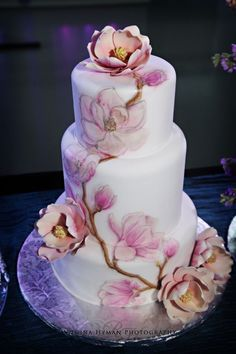 Both the fondant and the flowers were painted and airbrushed.
