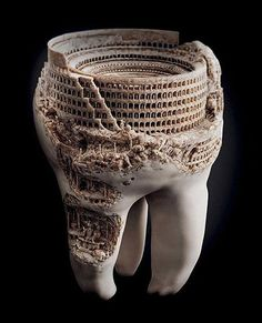 A sculpture of the Roman Colosseum, done in a real tooth.