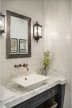Stylish Family Home with Transitional Interiors Kohler Purist (R) wall mount sink faucet and cross handles. Like wall paneling, marble, grey vanity. Pair with subway tile, black or nickel sconces, recessed sink. CR